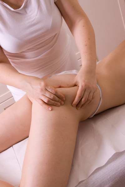 massage in the bottom of the body in beauty saloon