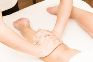 Foot massage treatment to the oriental women