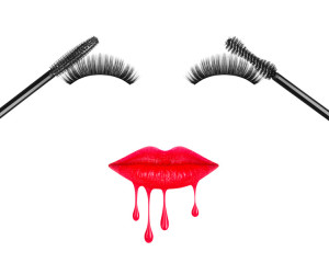 Black mascara brushes with false eyelashes and lips painted with lipstick, isolated on white background