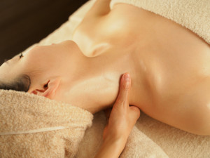 Japanese woman receiving neck massage at beauty salon